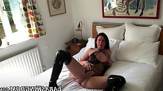 Busty English babe puts on her leather high heel boots solo